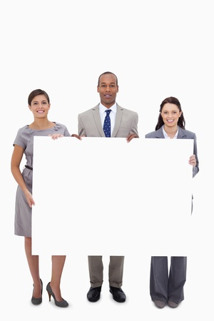 Businesspeople holding blank sign against a white background photo
