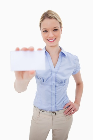 Woman holding blank business card against a white background photo