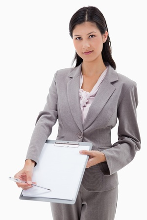 Businesswoman asking for signature against a white background photo