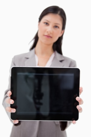 Businesswoman showing tablet screen against a white background photo