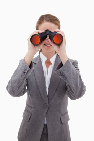 Bank employee looking through spyglasses against a white background photo