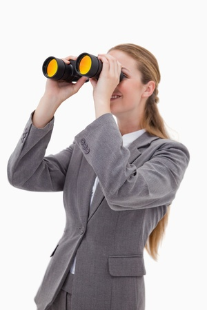Side view of bank employee with spyglasses against a white background photo