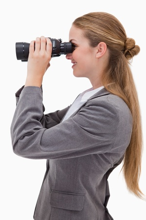 Side view of smiling bank employee with spyglasses against a white background photo