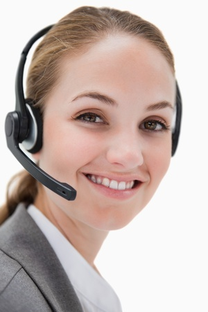 Smiling female call center agent working against a white background Stock Photo - 11685858