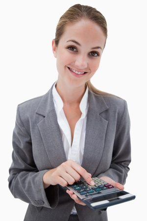 Smiling bank employee with pocket calculator against a white background photo