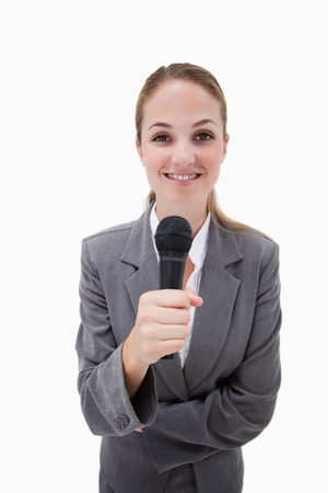 Smiling woman holding microphone against a white background photo