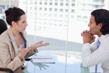 Business people negotiating in a meeting room photo
