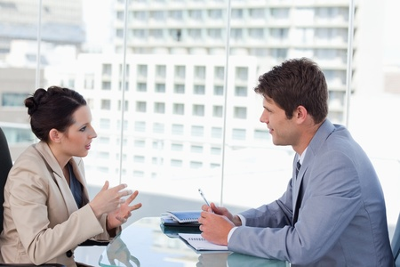 Business team negotiating in a meeting room photo