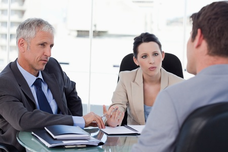 Business team negotiating with a customer in a meeting room photo