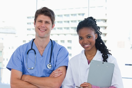 Happy doctors standing up in an office Stock Photo - 13616366