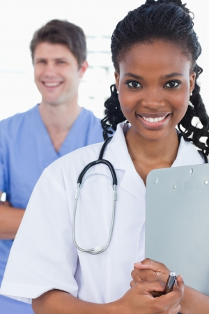 Portrait of doctors standing up in an office Stock Photo - 13616493