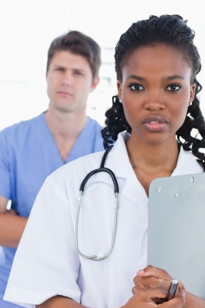 Portrait of serious doctors standing up in an office Stock Photo - 13616335