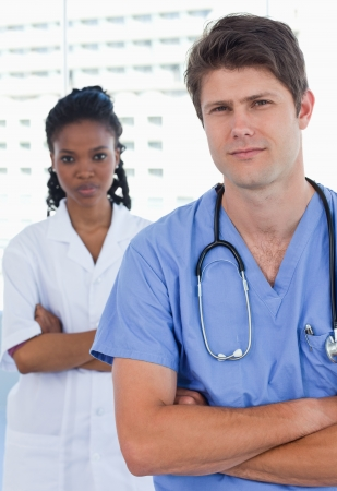 Portrait of professional doctors standing up in an office Stock Photo - 13600351