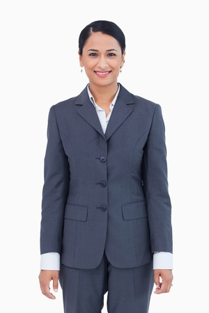 Smiling businesswoman against a white background photo