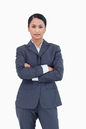 Serious businesswoman with folded arms against a white background Stock Photo - 13606483