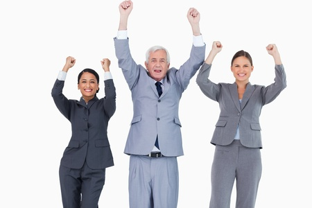 Three cheering businesspeople against a white background photo