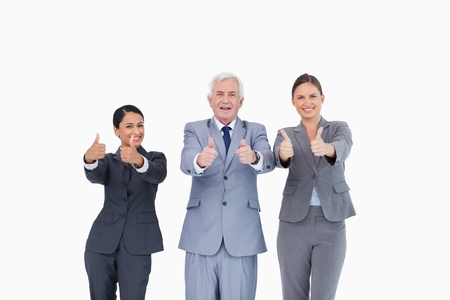 Three businesspeople giving thumbs up against a white background photo