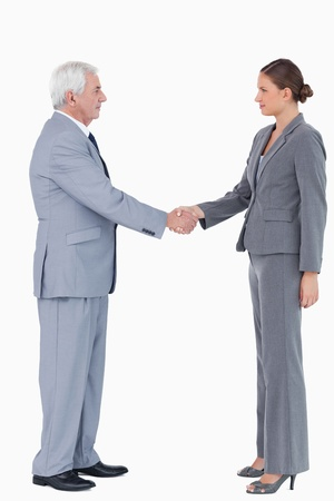 Side view of businesspartner shaking hands against a white background photo