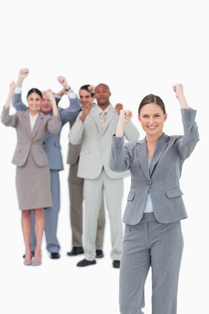 Cheering saleswoman with team behind her against a white background photo