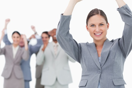 Cheering tradeswoman with team behind her against a white background photo