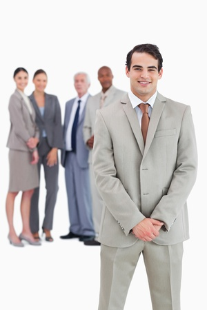 team from behind: Businessman with team behind him against a white background