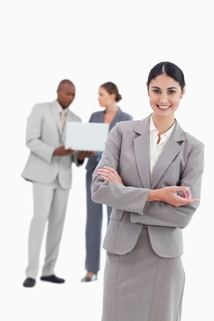 Saleswoman with talking colleagues behind her against a white background photo