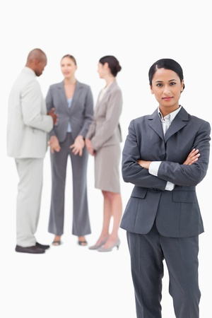 confident saleswoman with negotiating trading partners behind her against a white background photo