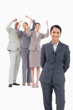 Saleswoman with cheering team behind her against a white background photo