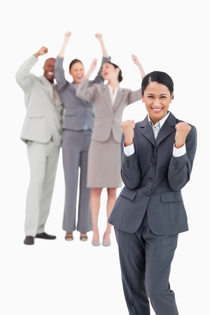 Successful saleswoman with cheerful team behind her against a white background photo
