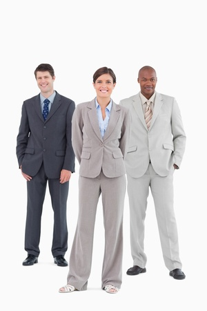 Salesteam standing together against a white background photo