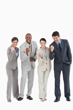 Businessteam being aggressive against a white background photo
