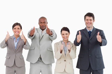 Salesteam giving thumbs up against a white background Stock Photo - 13608766