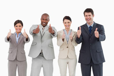 Smiling salesteam giving thumbs up against a white background photo