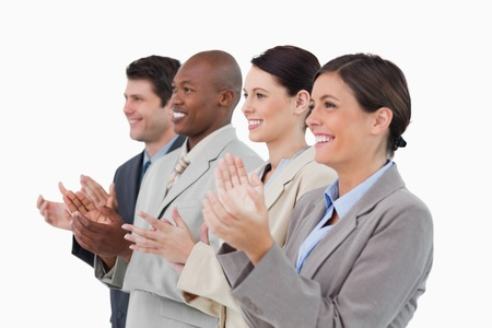 Side view of clapping salesteam standing together against a white background Stock Photo - 13607284