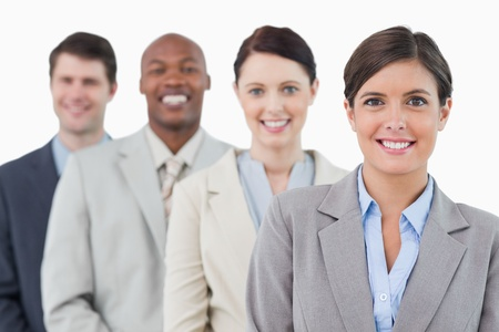 Smiling young businessteam standing against a white background photo