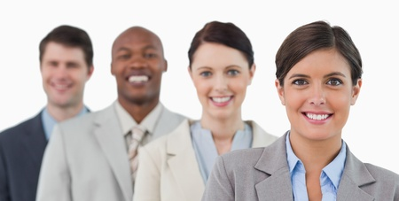 Smiling young salesteam standing together against a white background photo