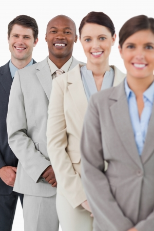 Confident smiling salesteam standing together against a white background photo