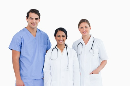 Smiling medical staff standing together against a white background photo