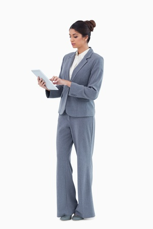 Businesswoman using tablet computer against a white background photo
