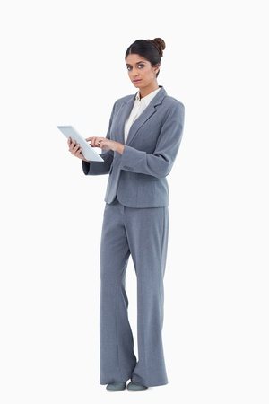 Saleswoman using tablet against a white background photo