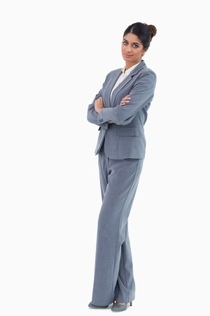 Businesswoman standing with folded arms against a white background Stock Photo - 13601854