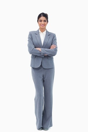 Smiling businesswoman with her arms folded against a white background Stock Photo - 13603668