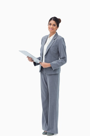 Smiling saleswoman with clipboard against a white background photo