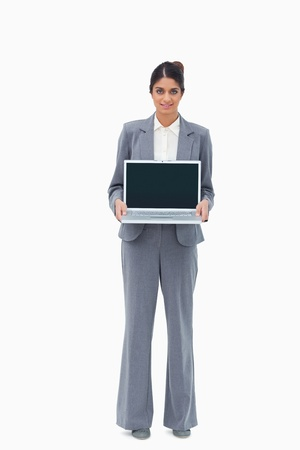 Saleswoman showing the screen of her laptop against a white background photo