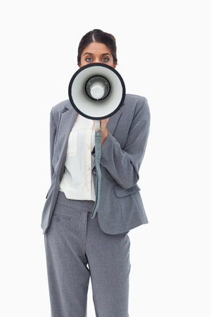 Saleswoman using megaphone against a white background photo