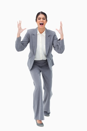 Angry yelling businesswoman against a white background photo