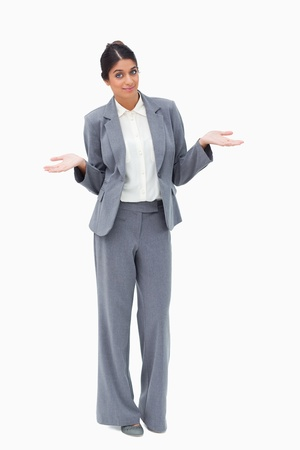 unsuspecting: Saleswoman being clueless against a white background Stock Photo