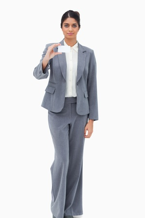 Saleswoman showing blank business card against a white background photo