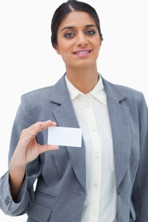 Tradeswoman showing blank business card against a white background photo