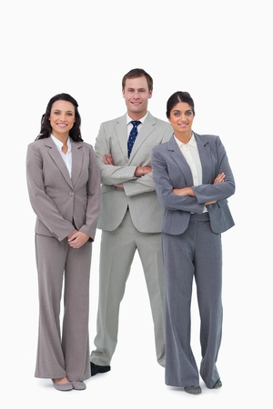 Young businessteam with arms folded against a white background photo